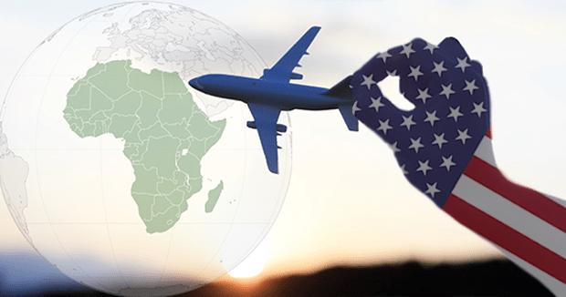 Hand holding model plane of Africa globe