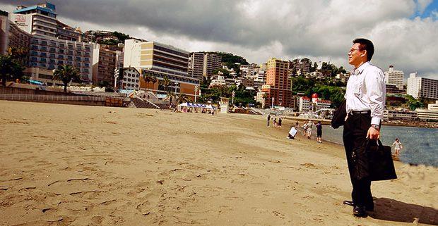 Businessman on beach