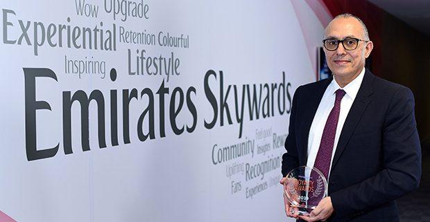 Dr Nejib Ben Khedher, Senior Vice President at Emirates Skywards, holding their Loyalty Award 2019