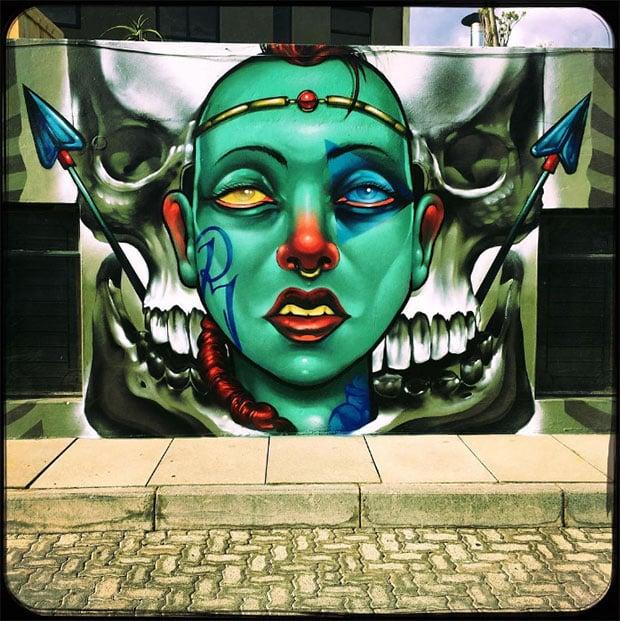 Graffiti of spears and skull in Johannesburg by street artist Rekso le Hond