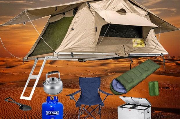 Camping gear against a desert sunset